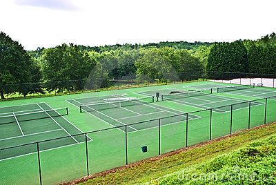 A Row of Empty Tennis Courts