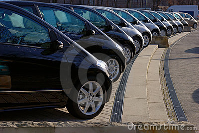 Row of gray and black cars