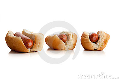 A row of hot dogs and buns on white
