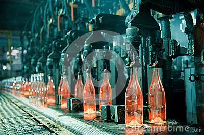 Row of hot orange glass bottles
