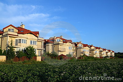 Row of houses over blue sky