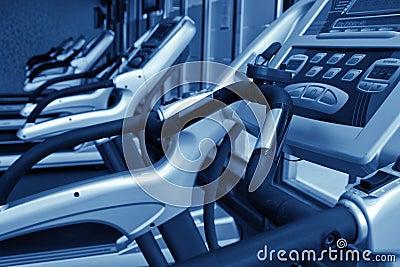 Row of jogging simulators, monochromatic