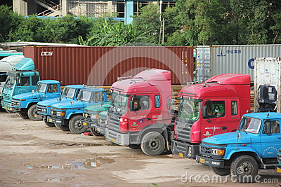 A row of large container trucks  in SHENZHEN shekou port Editorial Image