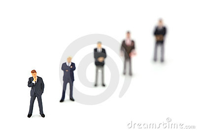 Row of miniature business men