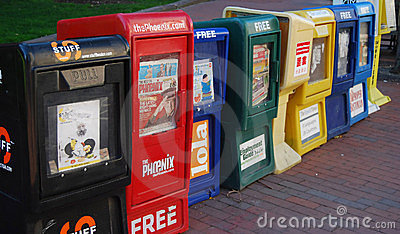 Row of newspaper boxes on the street Editorial Image