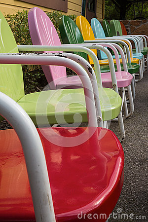 Free Row Of Colorful Vintage Metal Lawn Chairs Royalty Free Stock Image - 89111426