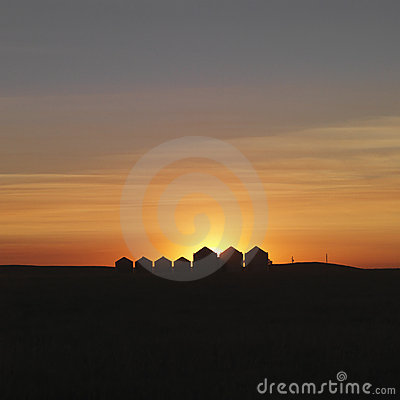 Free Row Of Houses Silhouetted At Sunset Royalty Free Stock Image - 12960186