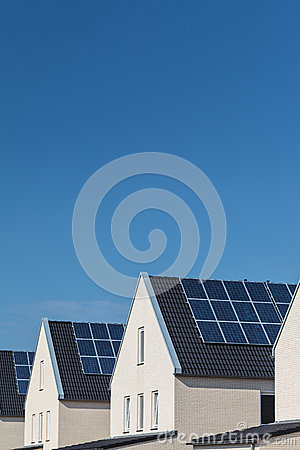 Free Row Of New Houses With Solar Panels On The Roofs Royalty Free Stock Photo - 26483085