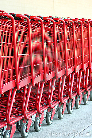 Free Row Of Red Metal Shopping Carts Royalty Free Stock Photography - 6487377