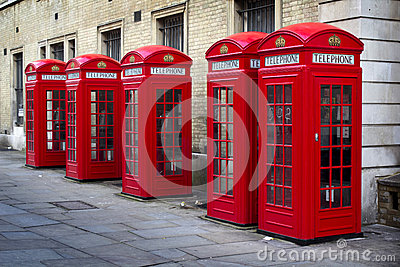 Row of old style UK red phone boxes