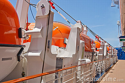 Row of Orange Lifeboats by Deck of Cruise Ship