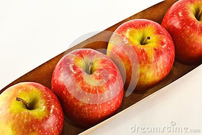Row of pink lady apples