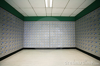 A row of post office boxes in a  post office.