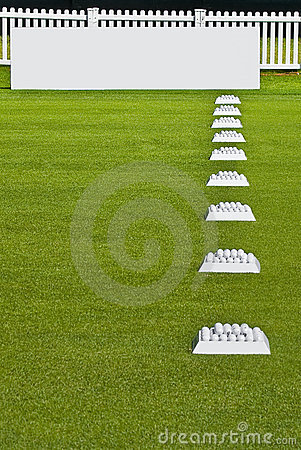 Row of Practice Balls, Blank Signage Boards