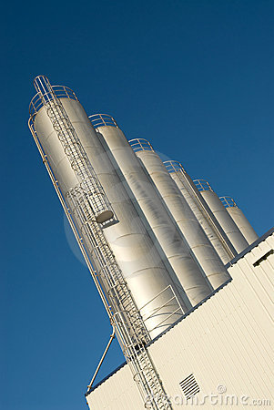 Row of silos and blue sky