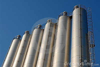 Row of steel silos and sky