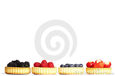 Row of tartlets with wild berries