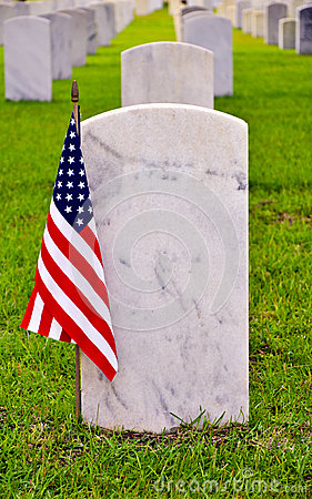 Row of tombstones with american flag