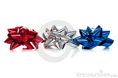 Row of various colored christmas bows on white