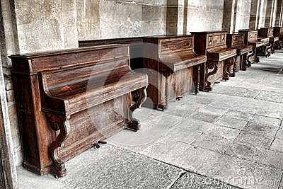 Row of Vintage Upright Piano in Old Music School