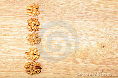 Row of walnuts on plank