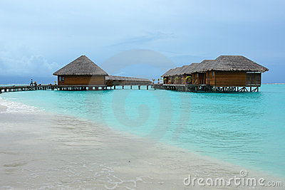 Row of water villas and jetty
