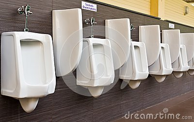 Row of white porcelain urinals