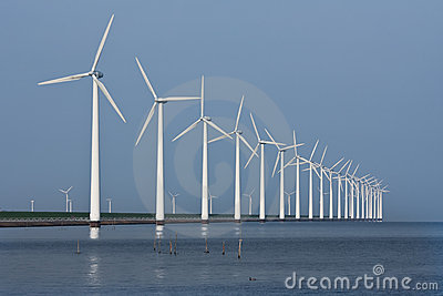 Row of windmills, mirrored in the Dutch sea