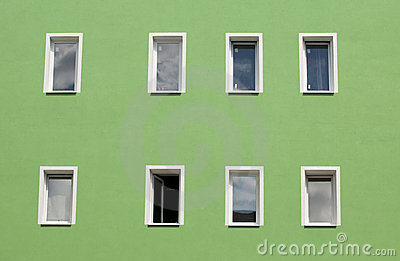 Row of windows on green wall