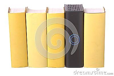 Row of yellow hardback books with a computer hard