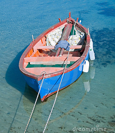 Rowboat in clear sea.