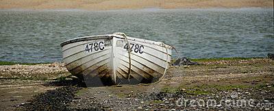 Rowboat on sea shore