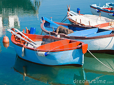Rowboats in clear sea.