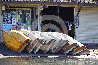 Row boats piled at general store Editorial Stock Photo