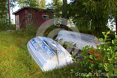 Rowboats in front of red shed