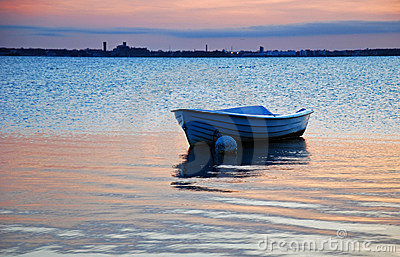 Rowing boat in calm reflecting sea
