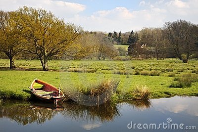 Rowing boat on river bank