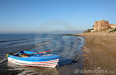 Rowing Boat in Sea at Sunrise in Spain