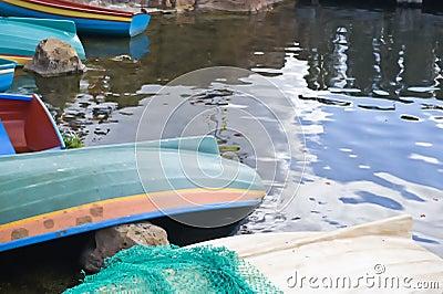 Rowing boats moored lakeside