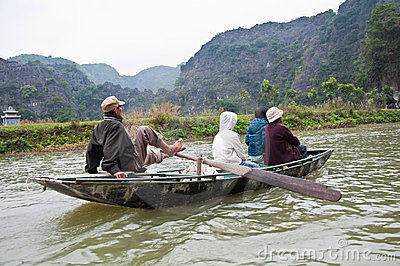 Rowing with feet, at Tam coc, vietnam Editorial Photo