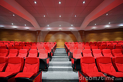 Rows of arm-chairs are in empty hall Stock Photo