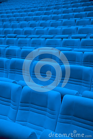 Rows of blue arm-chairs in empty hall