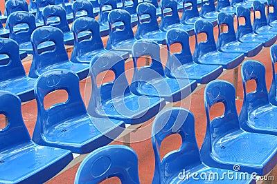 Rows of blue stadium seats