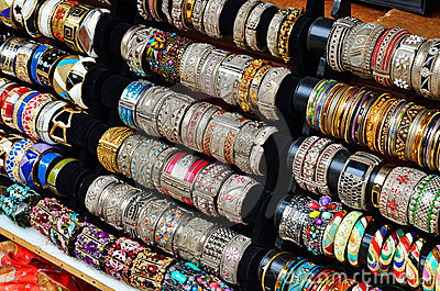 Rows of colorful bracelets on jewelry market