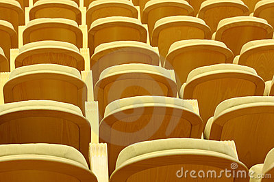 Rows of comfortable chairs with wooden back