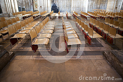 Rows of empty chairs inside Ely Cathedral Editorial Photography