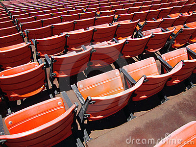 Rows of empty orange stadium seats