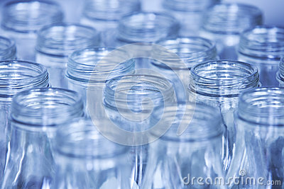 Rows of glass bottles ready for recycling, shallow depth of fiel
