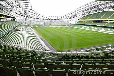 Rows of green seats in an empty stadium Aviva Editorial Photography