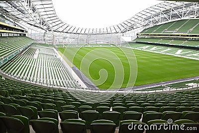Rows of green seats in an empty stadium Aviva Editorial Photography